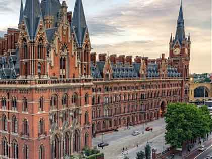 ornate redbrick Victorian building in London with tall spires